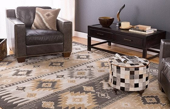 Southwest style area rug with leather accent chair Rustic Living Room Ideas