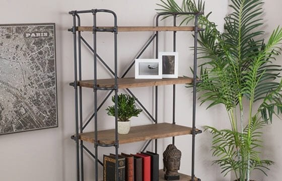 Industrial bookshelves with exposed pipes