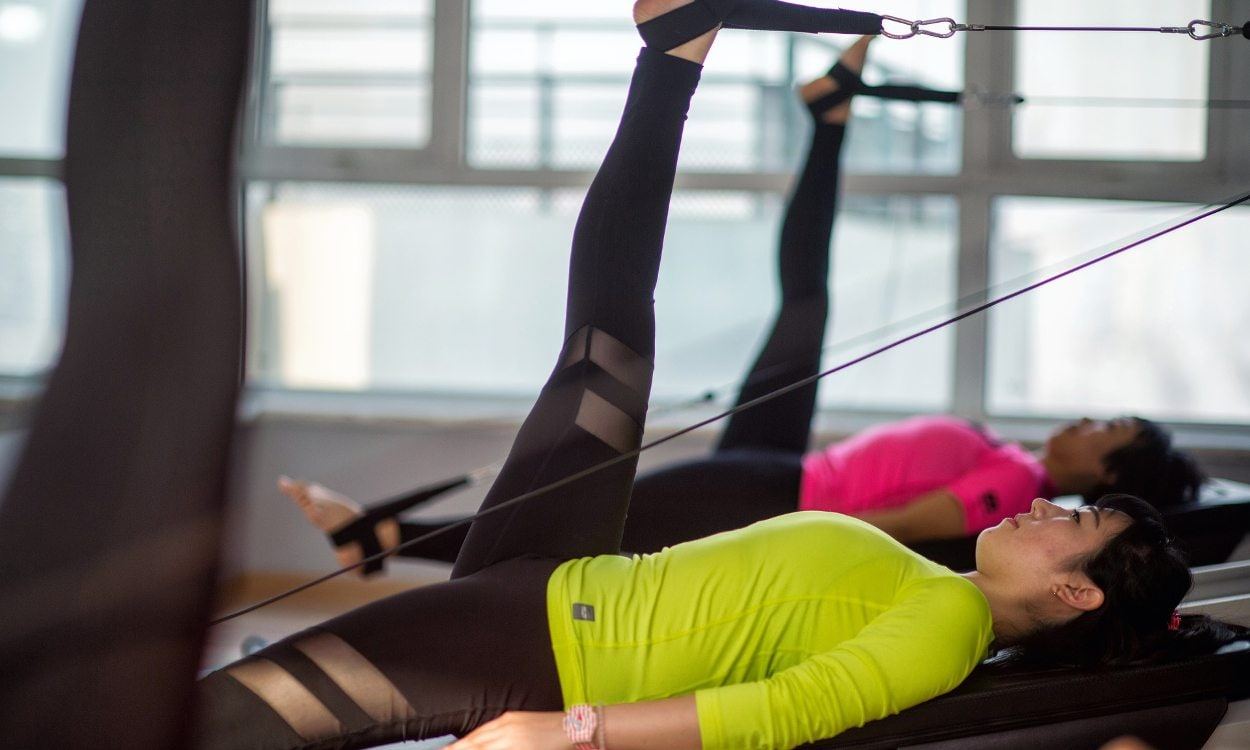 Women on a pilates reformer