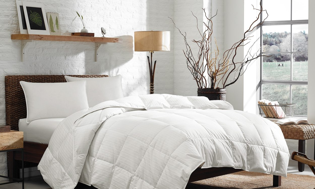 A bedroom with hotel bedding