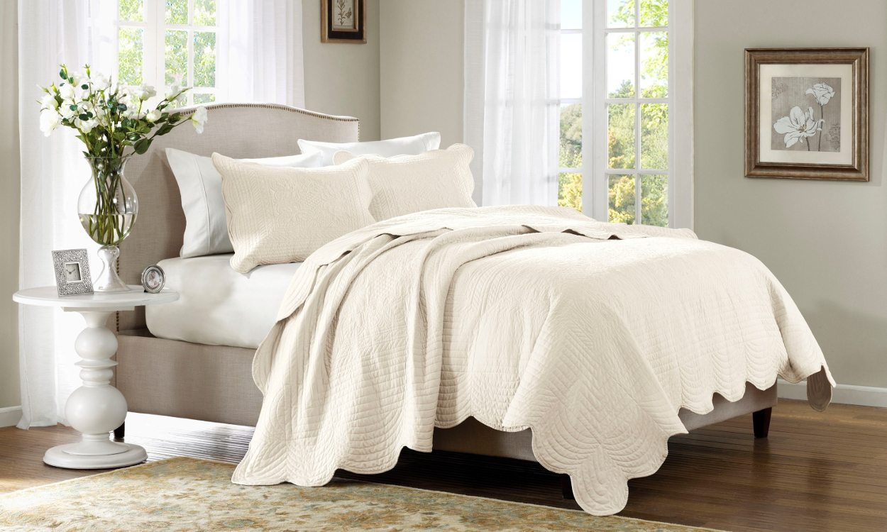 Cream bedding on bed