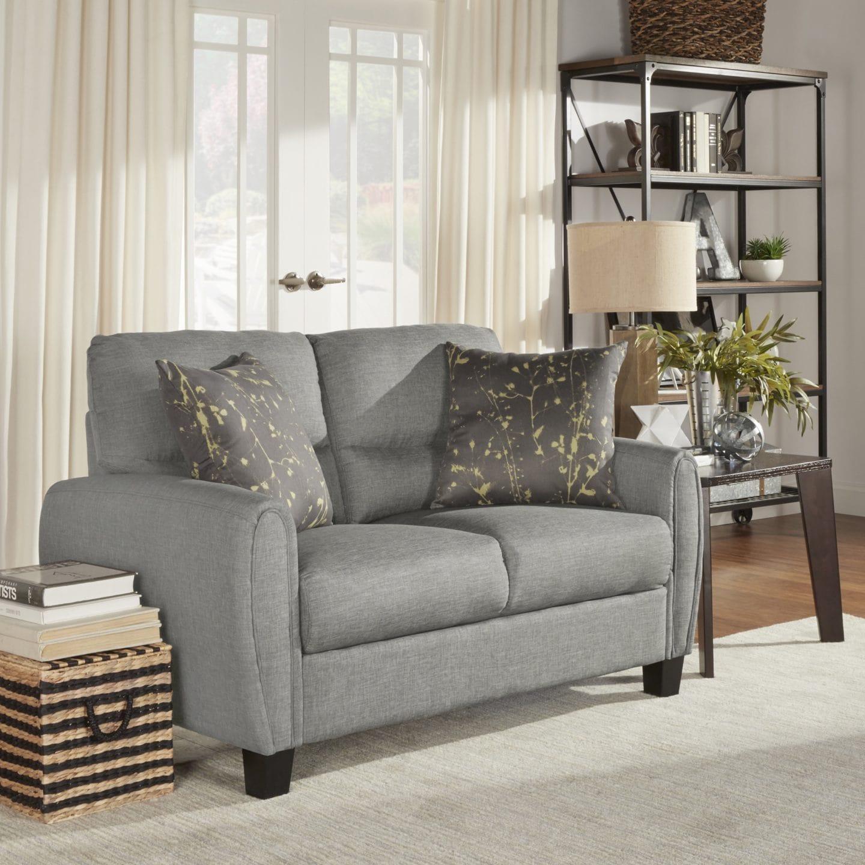 A grey loveseat sofa style