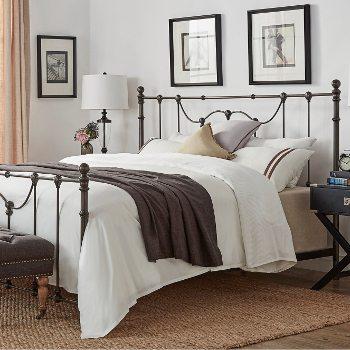 Metal bed in bedroom