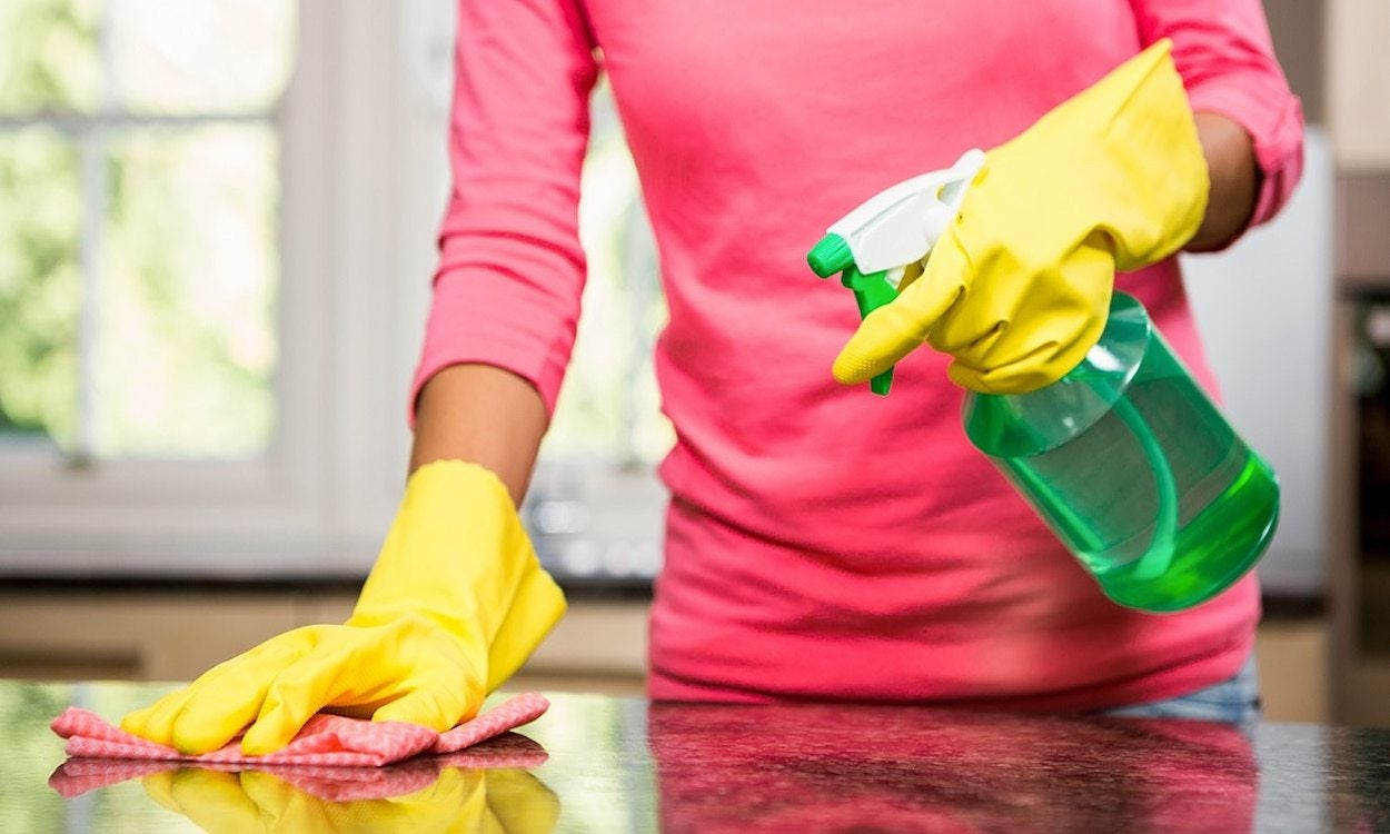 a woman cleaning the kitchen