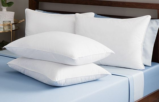 Pillows propped on wooden headboard guest bedroom ideas