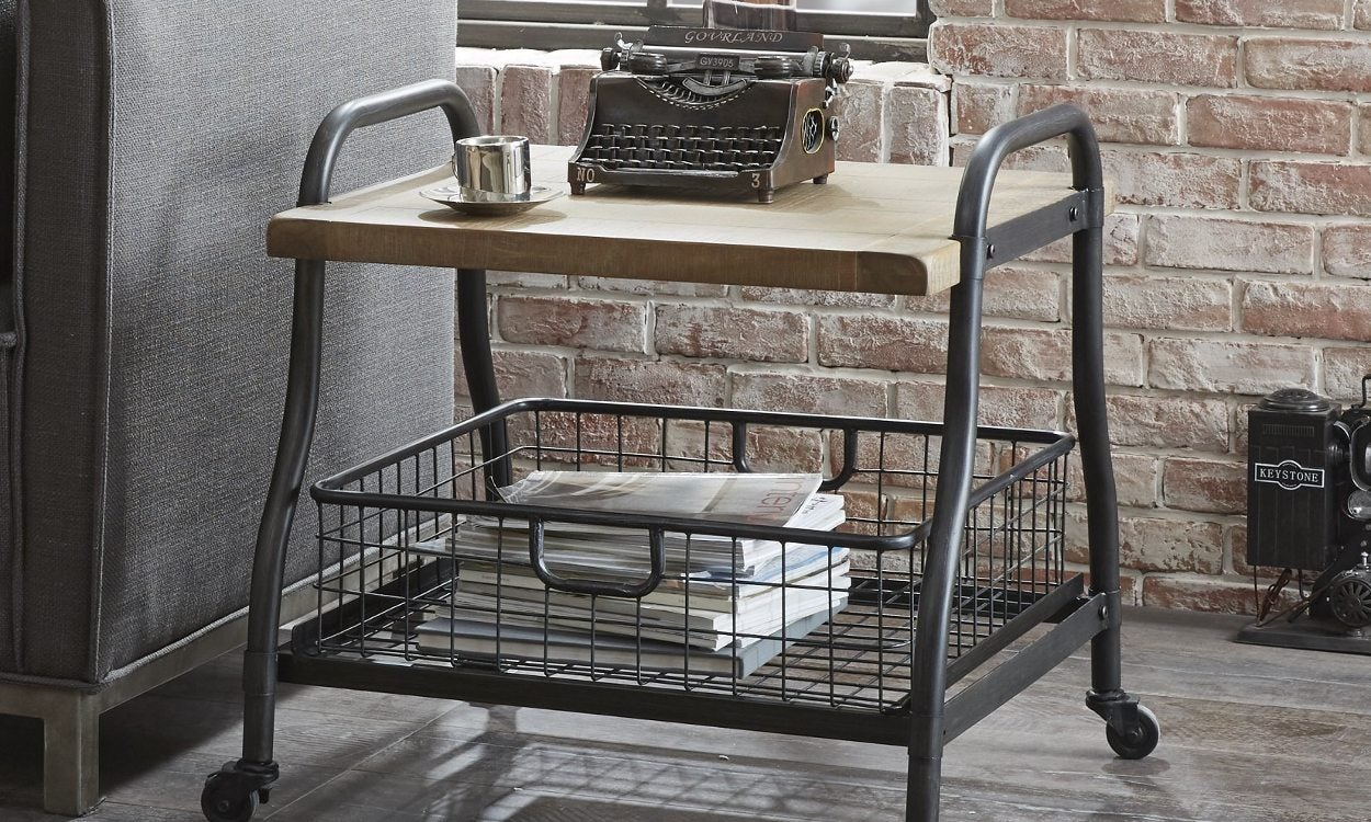 accent table on wheels with a typewriter on top