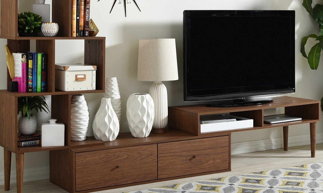 TV stand with attached shelves and drawers in a living room