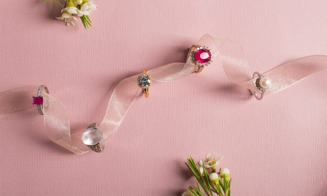 Birthstone rings strung on a ribbon