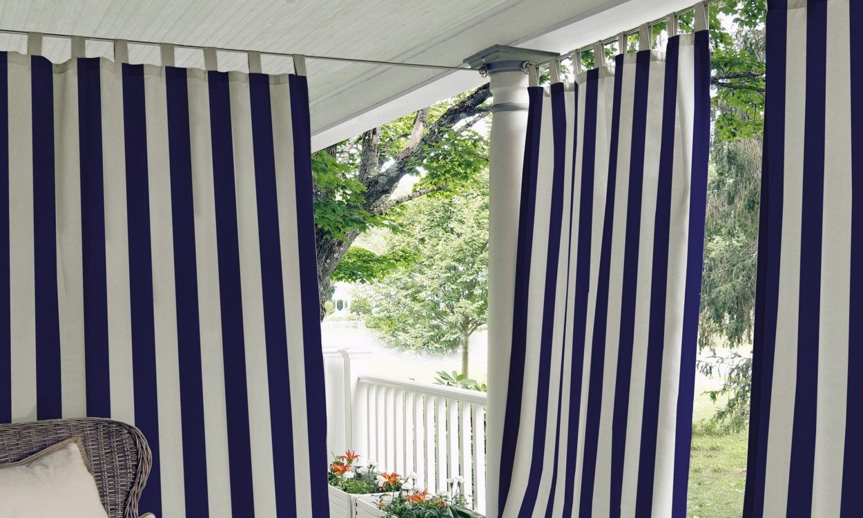 striped curtains on an outdoor porch