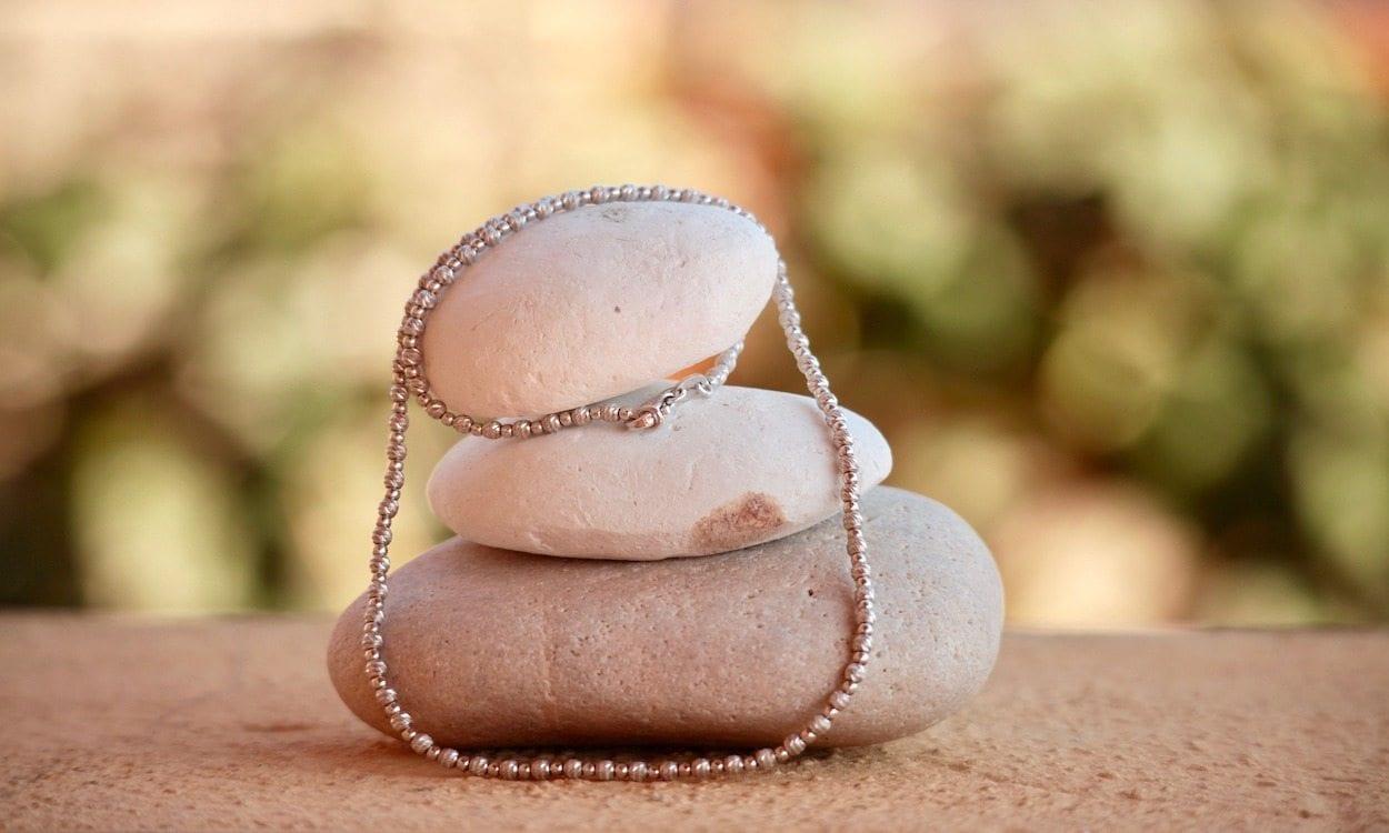 sterling silver necklace resting on rocks