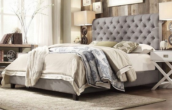 A coastal bedroom with layers of bedding - Coastal Furniture and Decor