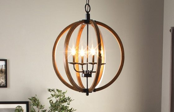 Orb chandelier hanging in a coastal dining room - Coastal Furniture & Decor Ideas