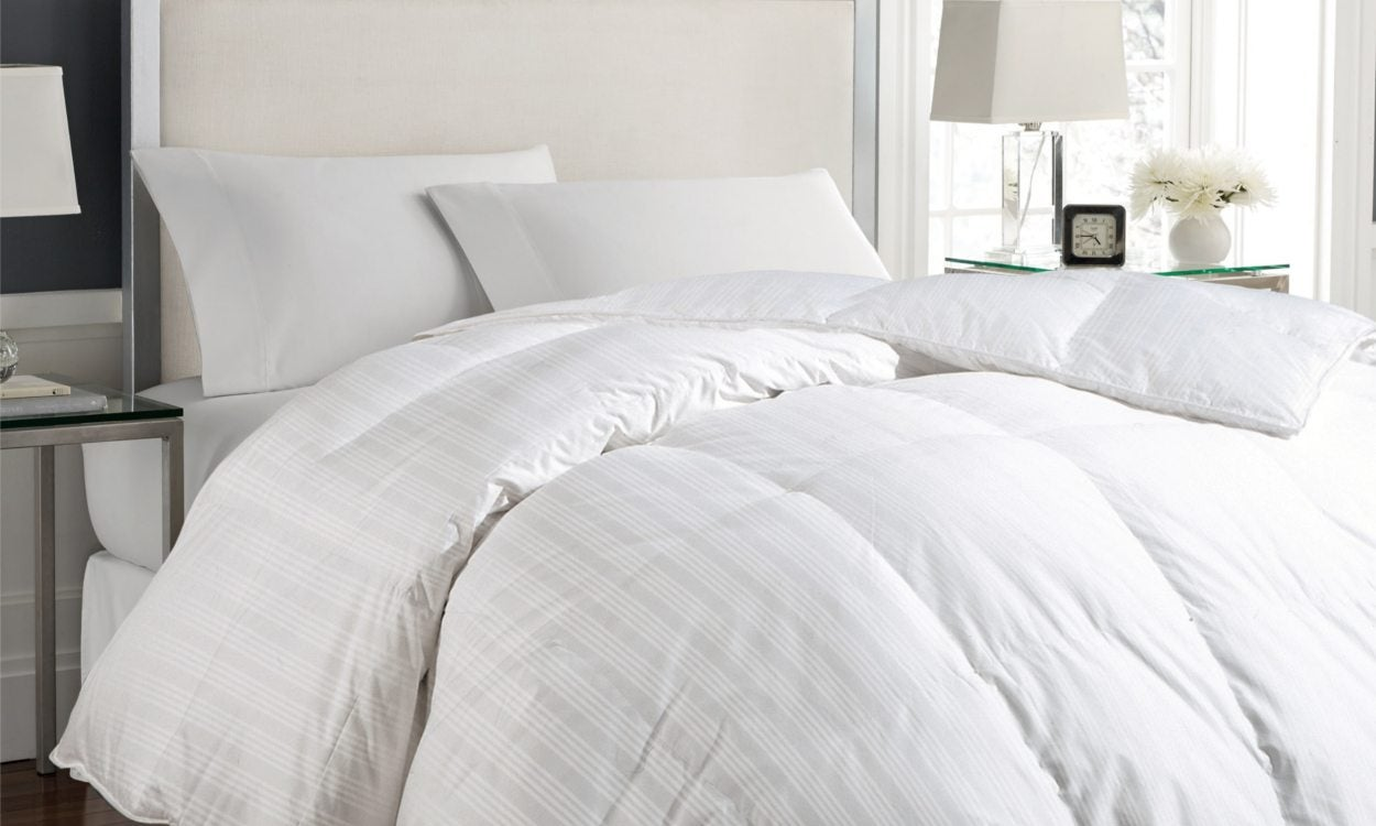 white down comforter on a bed