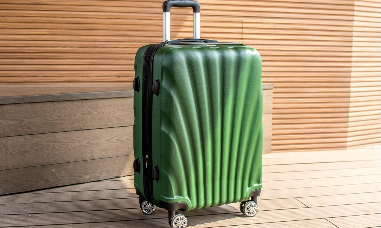 Green hardside Heys luggage