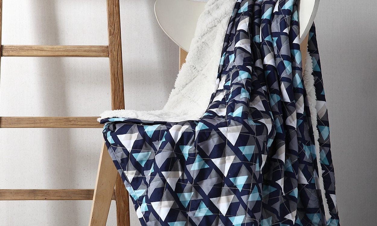 a chair with a blanket on it