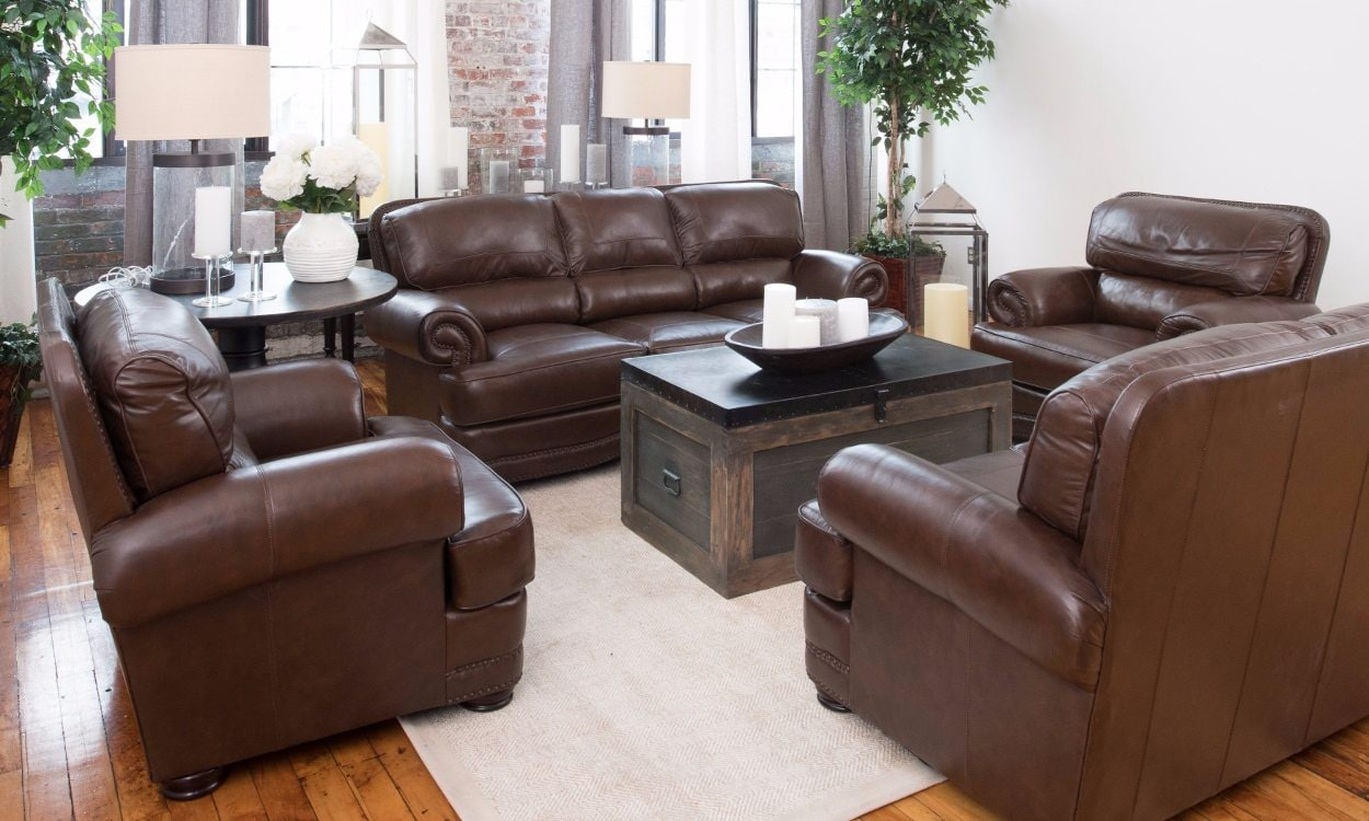 Brown leather furniture in a square living room