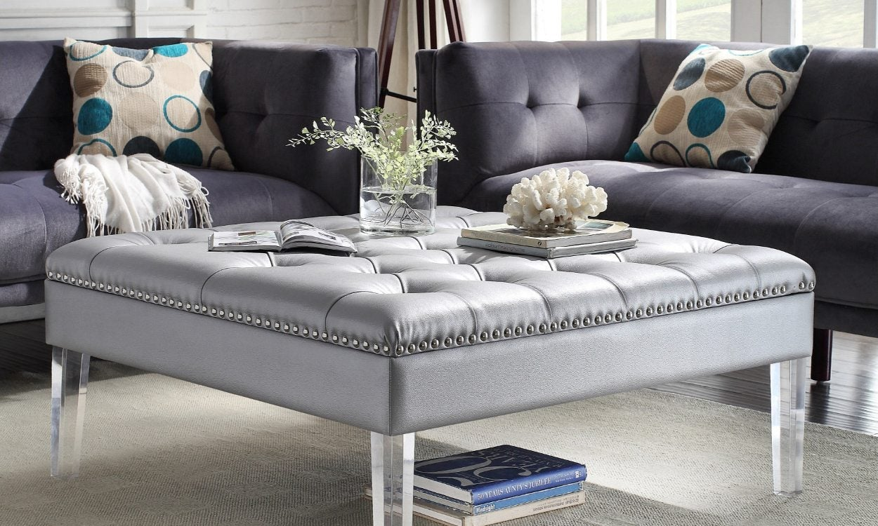 Ottoman buying guide a leather tufted ottoman in a living room