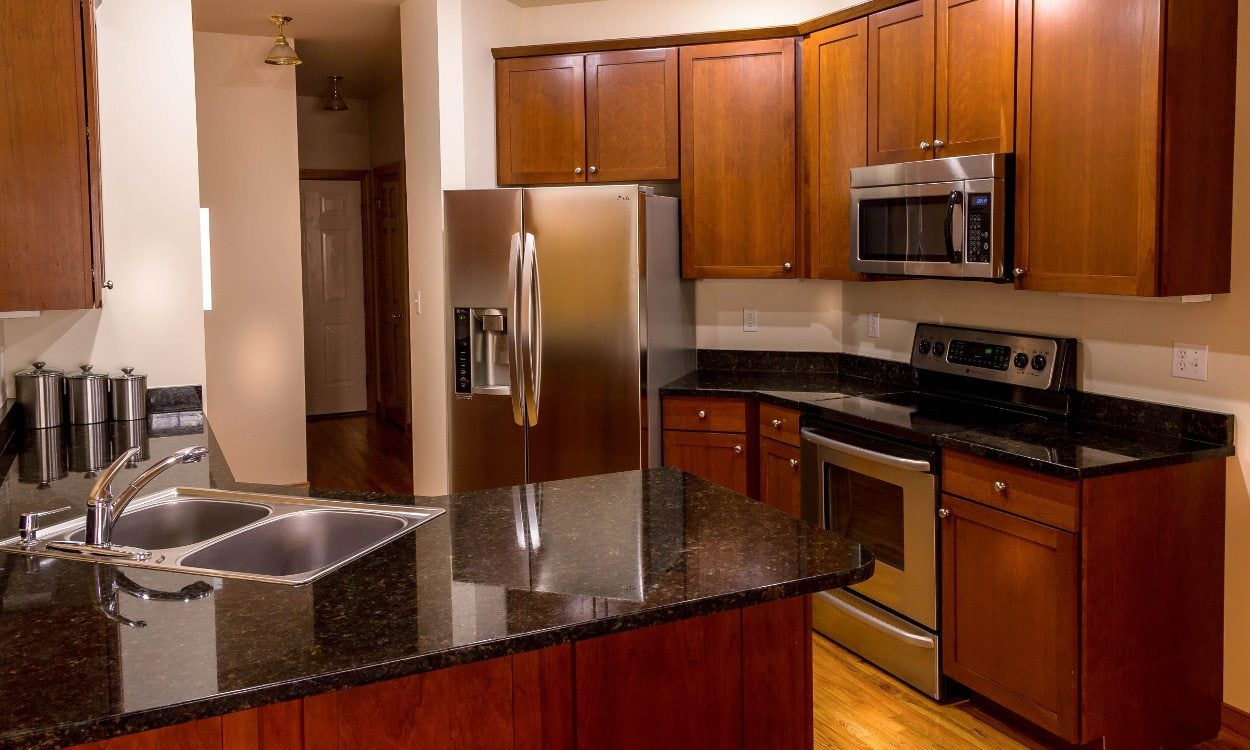 7 steps to refinishing your kitchen cabinets overstock com rh overstock com ways to refinish old kitchen cabinets Refacing Kitchen Cabinets