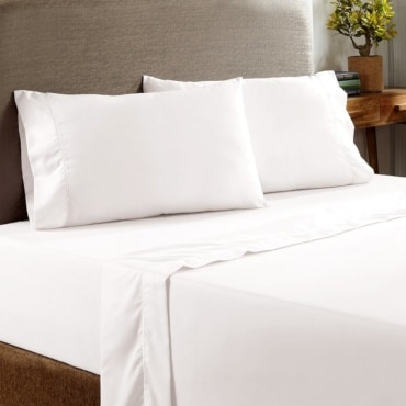 White flat sheets on a bed