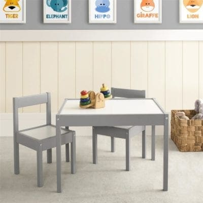 A grey and white kids table in a kids playroom, the perfect piece of kids furniture