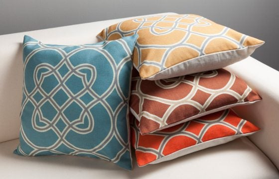 A stack of throw pillows under $50
