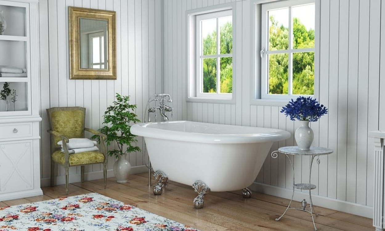 English cottage bathroom featuring a claw foot tub