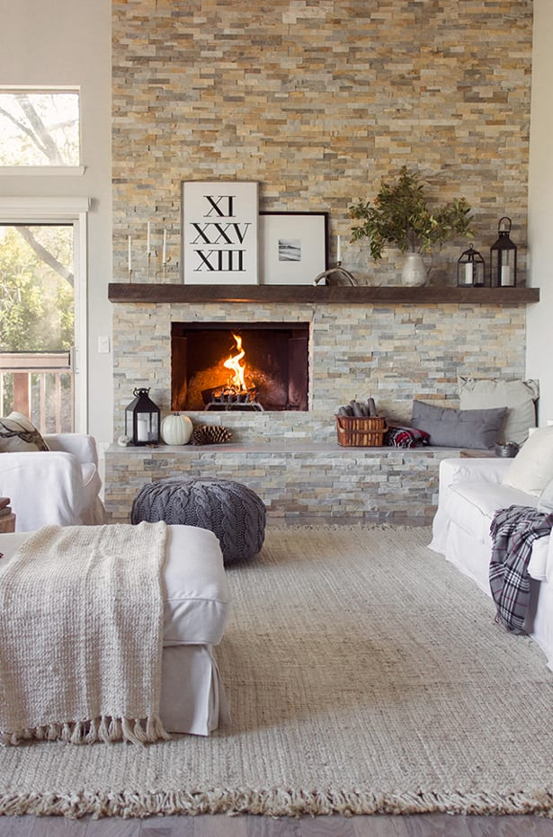 Lanterns & candles above fireplace