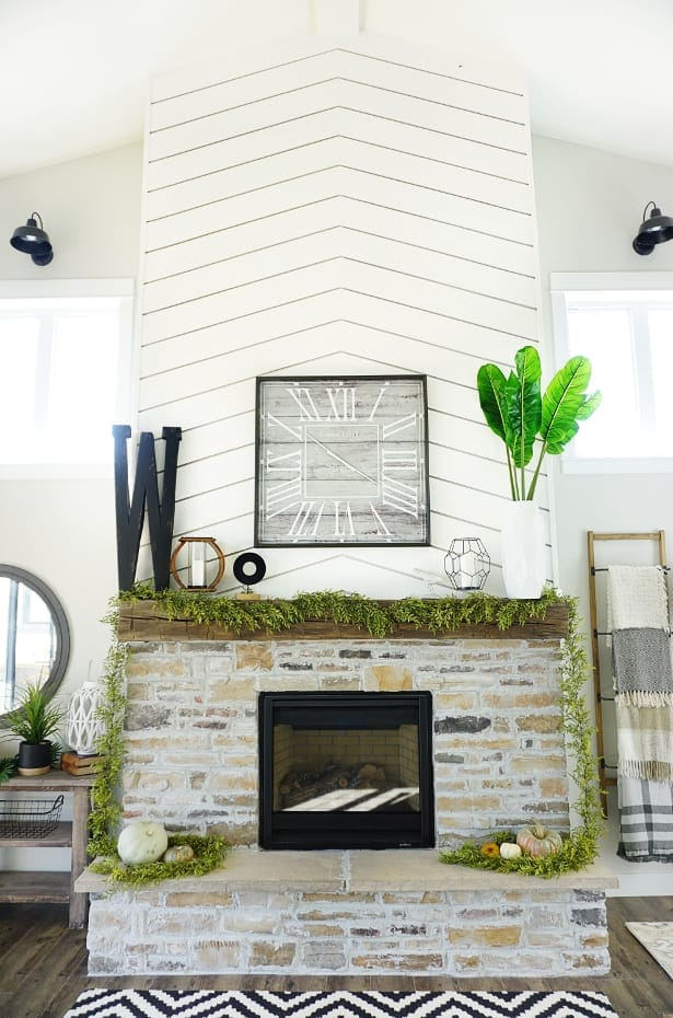 Decorative letter above fireplace