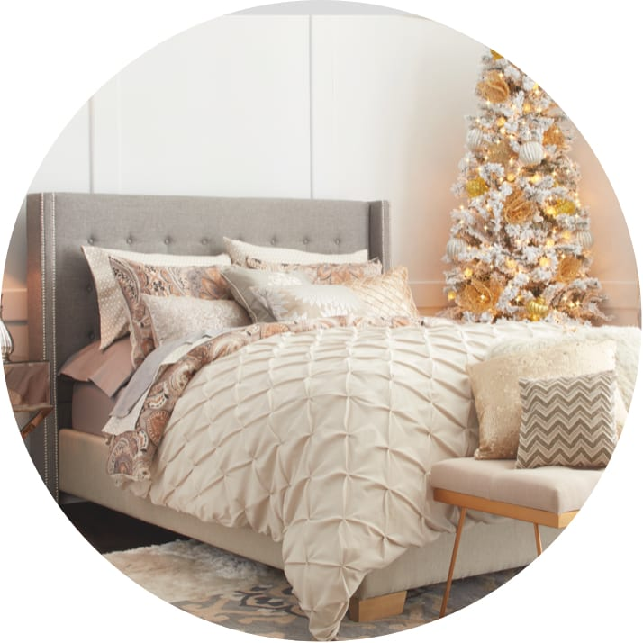 A cozy bedroom featuring bedding that you could give for Christmas