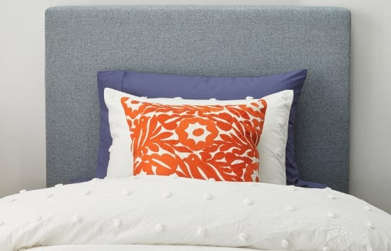 Twin Bed with 1 standard pillow and 2 accent pillows