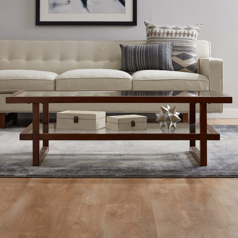 Two-tier coffee table with low profile decor