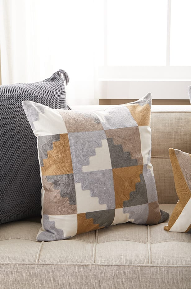 Different angles of throw pillows on a couch
