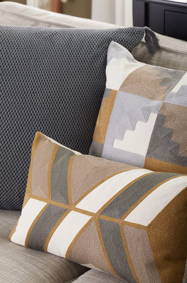 Different angles of throw pillows on a loveseat