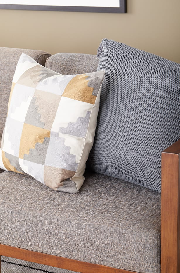 Different angles of throw pillows on a sectional