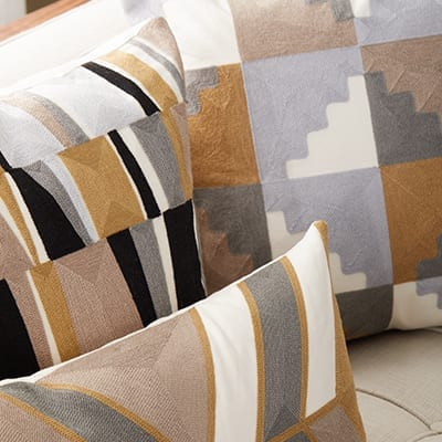 Patterned throw pillows on a sofa