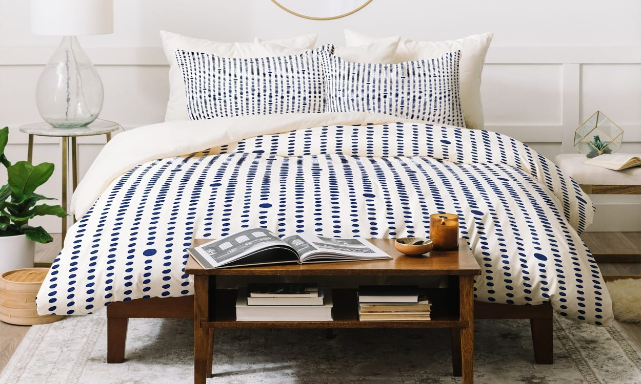 Beautifully decorated room with a blue and white striped duvet cover.