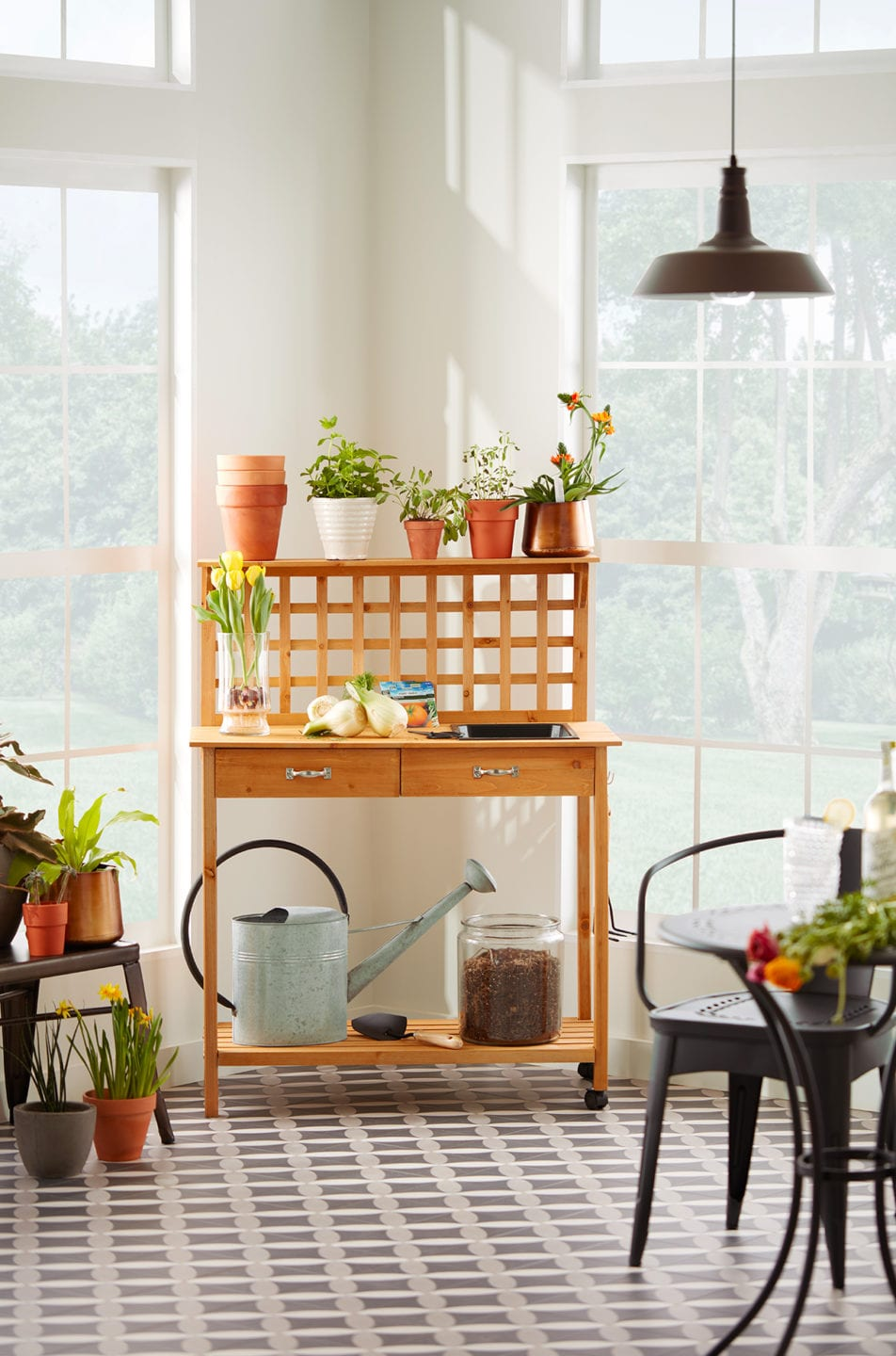 Sunroom decorated as a garden and potting room.