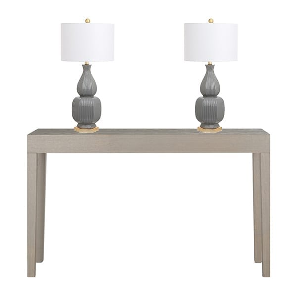 Set of grey table lamps on a console table.