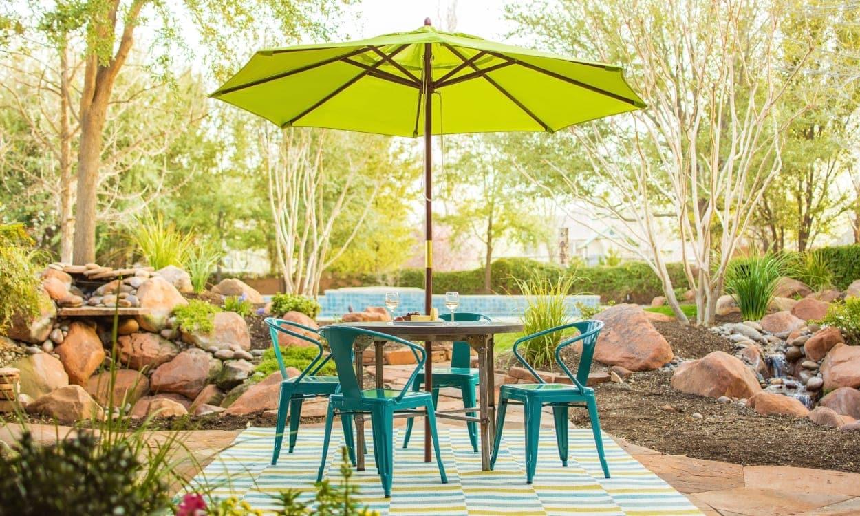 Outdoor patio table with umbrella. Patio Decorating Ideas