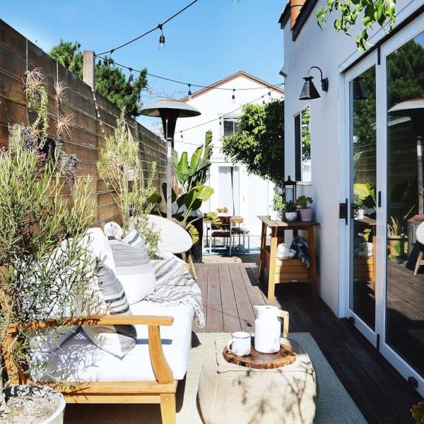 Outdoor patio with a wooden fence