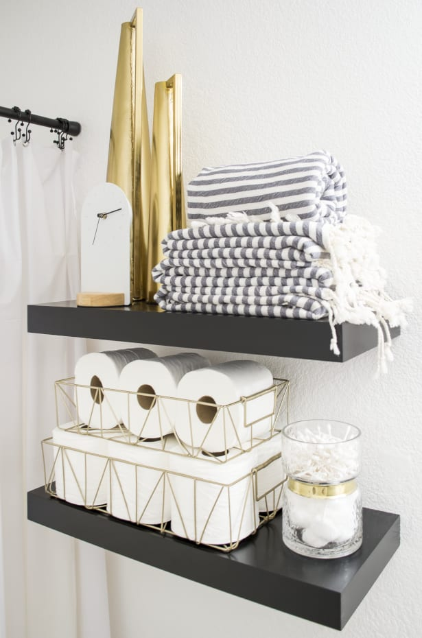 Black Floating Shelves with towels and Toilet Paper