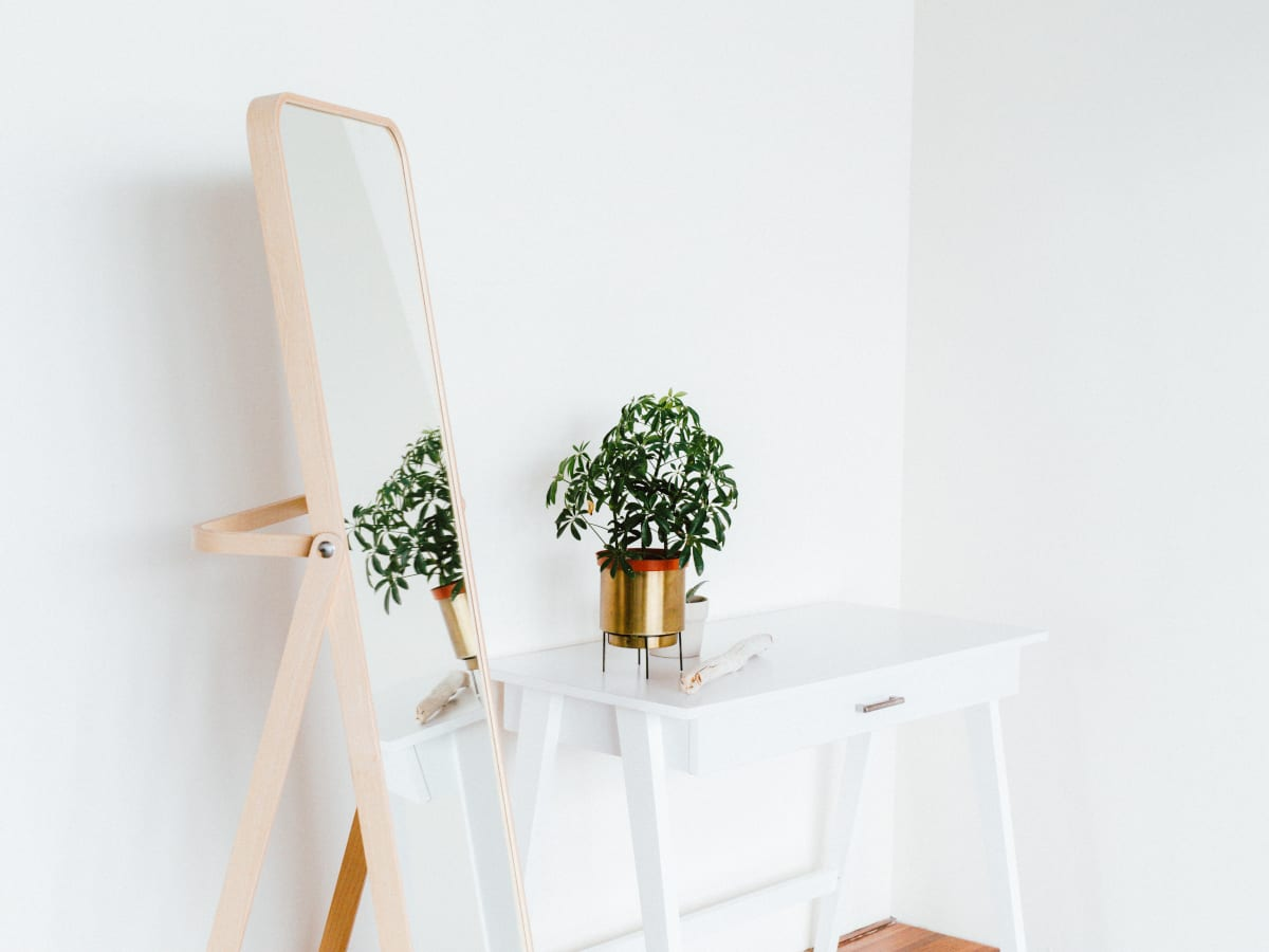 White Desk With a Plant in a Gold Pot