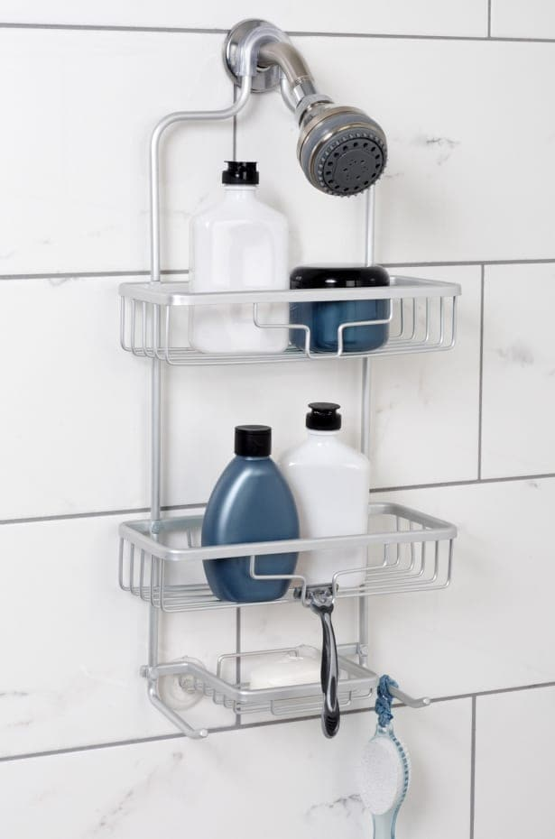 Aluminum shower caddy with shower accessories.