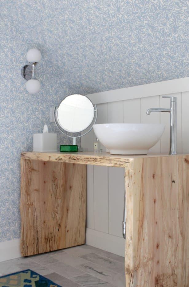 White vessel sink on a wood vanity.