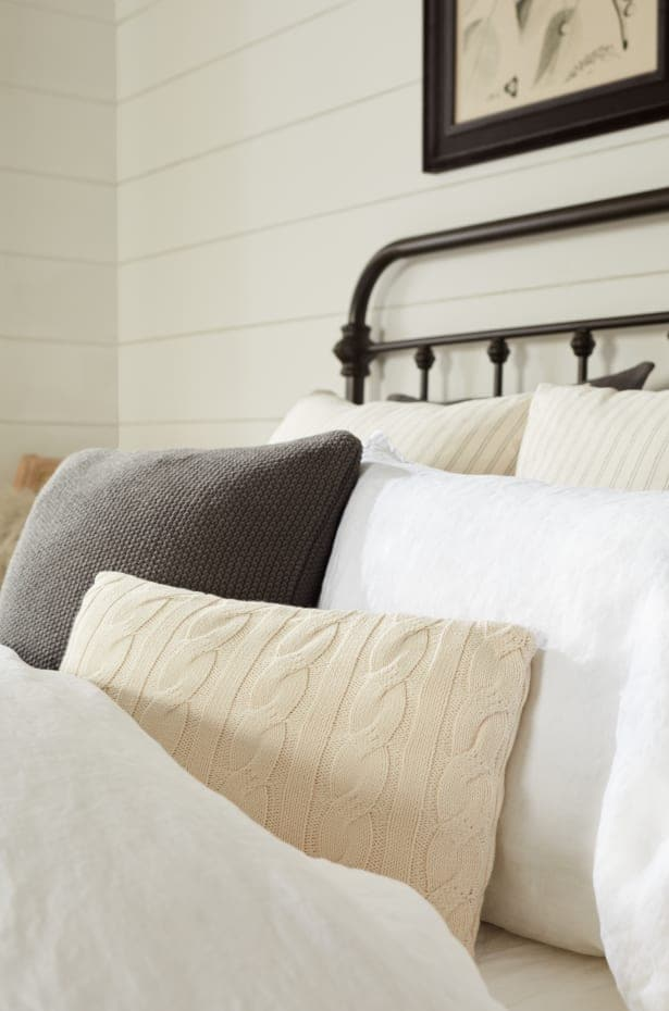 Pair A Black Bedframe With Neutral Bedding