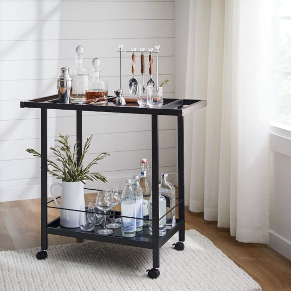 Glasses and barware on a bar cart