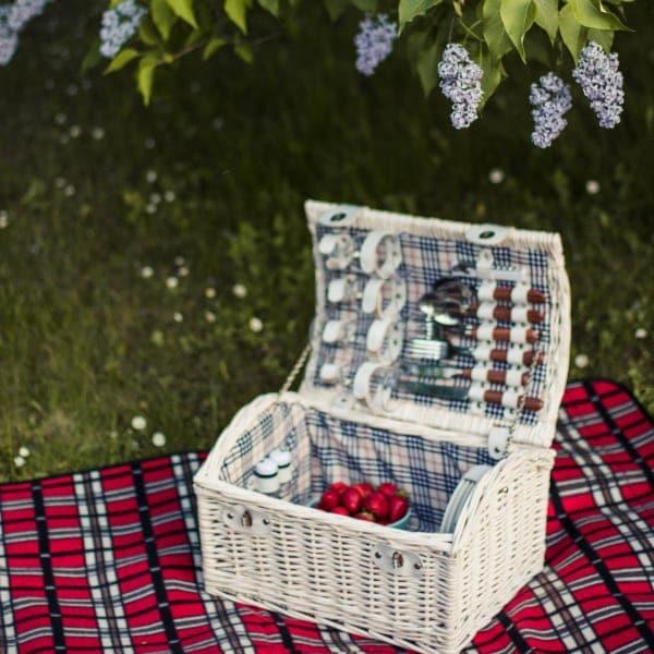 White picnic basket on a blanket