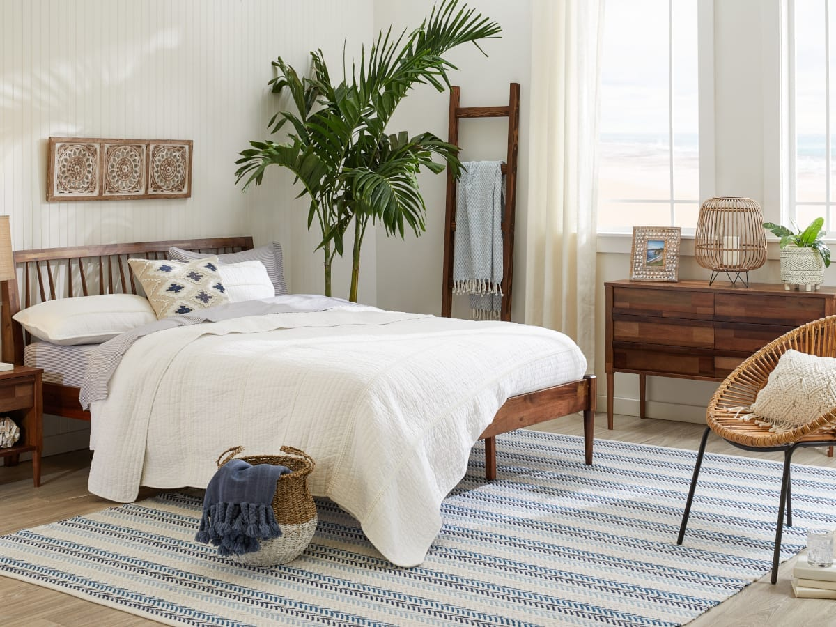 Bedroom showing a coastal rug