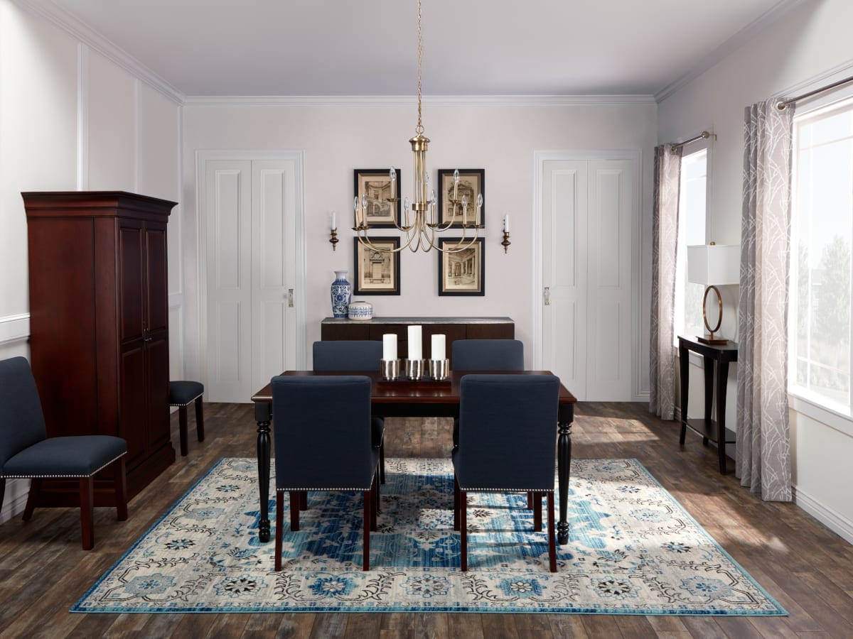 Dining room showing a traditional rugs