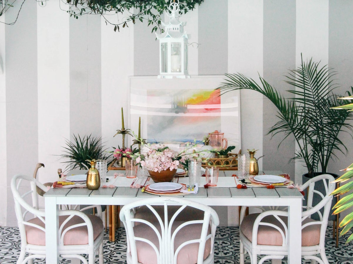 Patio decorated in a tropical glam style
